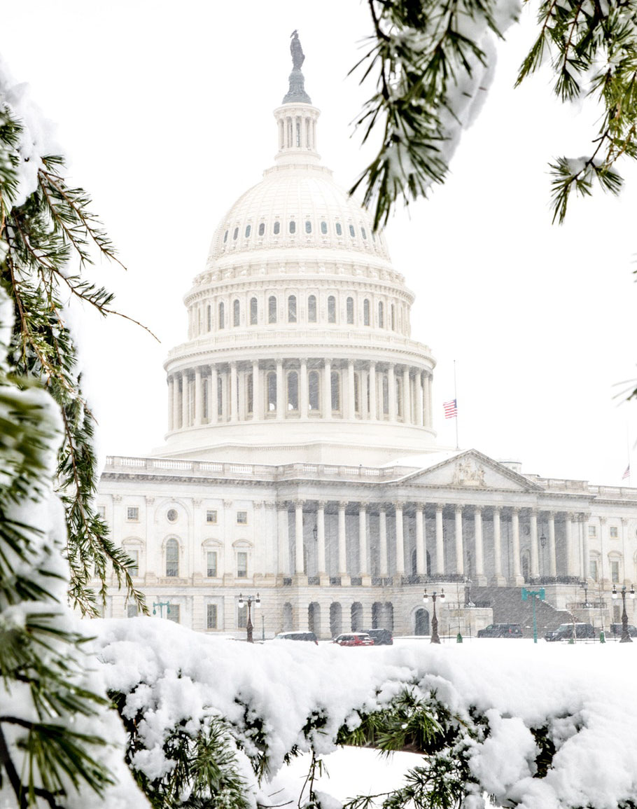 The Capitol building is covered in snow